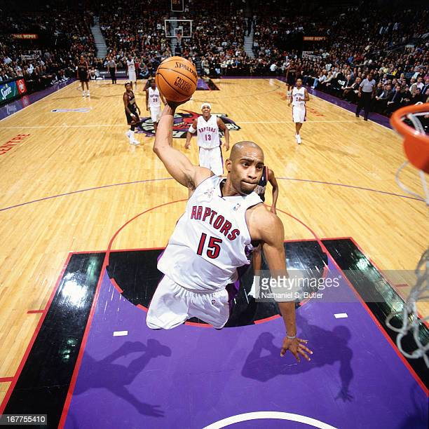 Vince Carter of the Toronto Raptors dunks the ball against the Denver Nuggets at Air Canada Centre in Toronto, Canada circa 2001. NOTE TO USER: User...