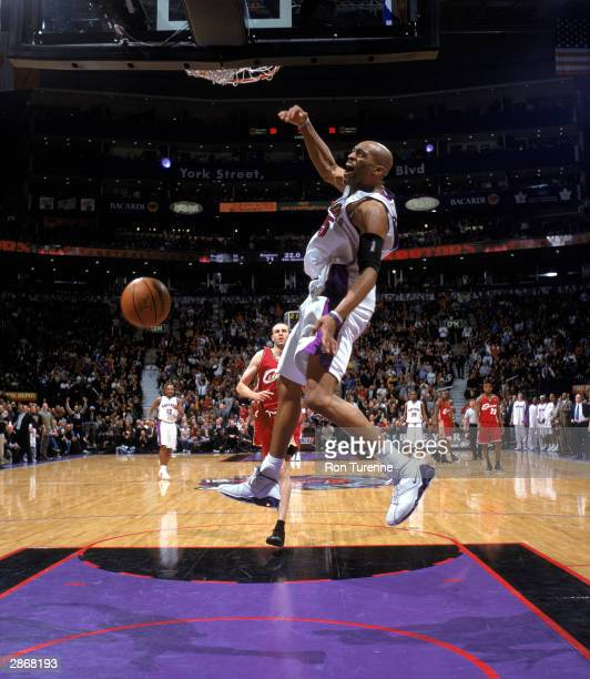 Vince Carter of the Toronto Raptors dunks the ball during the NBA game against the Cleveland Cavaliers at Air Canada Centre on January 7 2004 in...