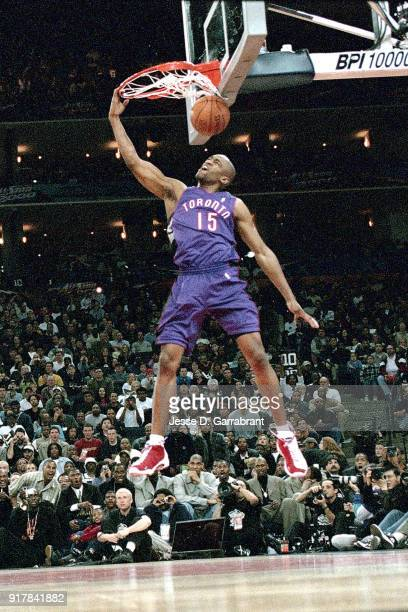 Vince Carter of the Toronto Raptors goes for a dunk during the 2000 NBA All Star Slam Dunk Contest at The Arena In Oakland on February 12 2000 in...