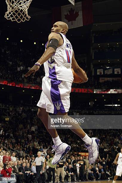 Vince Carter of the Toronto Raptors goes in for the dunk against the Cleveland Cavaliers during the game at Air Canada Centre on January 7 2004 in...