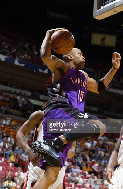 Vince Carter of the Toronto Raptors goes to the basket against the Miami Heat during the game at American Airlines Arena on March 21, 2003 in Miami,...