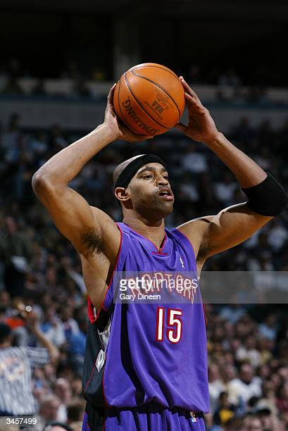Vince Carter of the Toronto Raptors holds the ball during the game against the Milwaukee Bucks at Bradley Center on April 14 2004 in Milwaukee...
