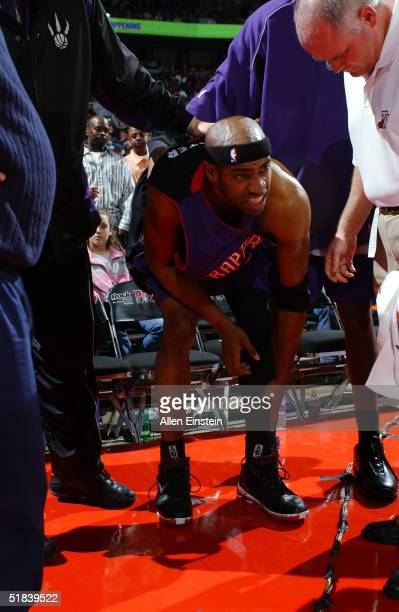 Vince Carter of the Toronto Raptors is injured during play against the Detroit Pistons on December 8, 2004 during their game at the Palace of Auburn...