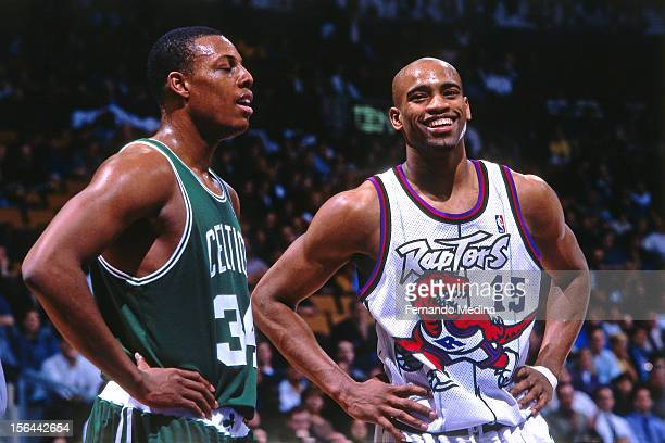 Vince Carter of the Toronto Raptors laughs with Paul Pierce of the Boston Celtics during a game circa 1999 at the Air Canada Centre in Toronto Canada...