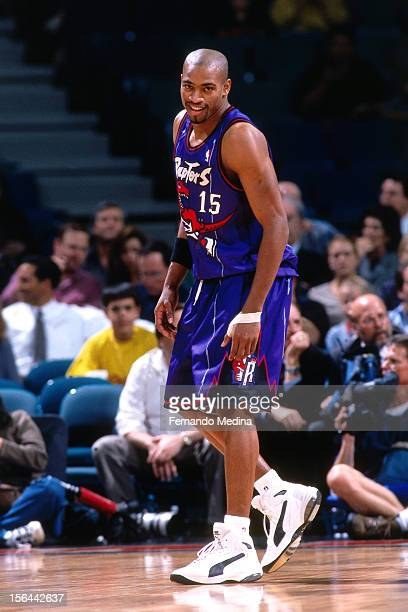 Vince Carter of the Toronto Raptors looks on during a game circa 1999 at the Air Canada Centre in Toronto Canada NOTE TO USER User expressly...