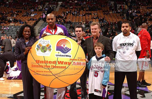 Vince Carter of the Toronto Raptors Michelle Carter and three radio contest winner fans 19yearold Shane Randell of Brampton 28yearold Lanny Simmonds...
