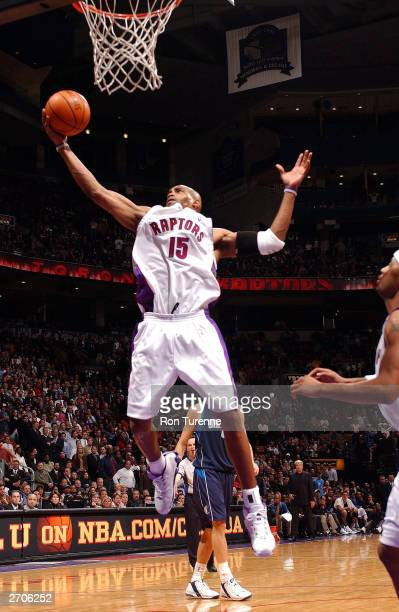 Vince Carter of the Toronto Raptors pulls down the defensive reboubd against the Dallas Mavericks on November 6 2003 at the Air Canada Centre in...