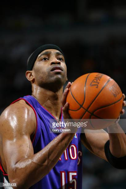 Vince Carter of the Toronto Raptors shoots a free throw during the game against the Milwaukee Bucks at Bradley Center on April 14 2004 in Milwaukee...