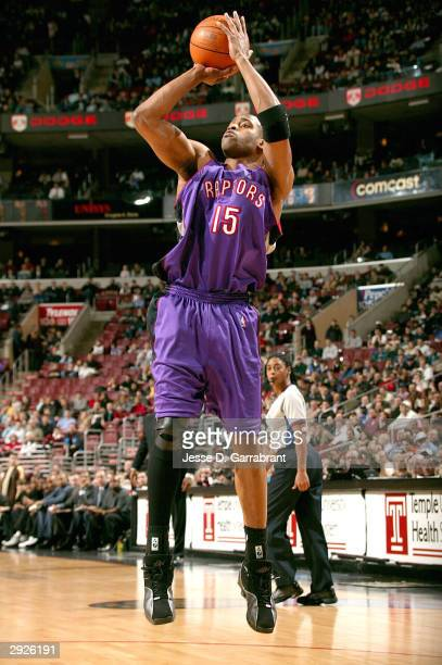 Vince Carter of the Toronto Raptors shoots against the defense of the Philadelphia 76ers February 3 2004 at the Wachovia Center in Philadelphia...