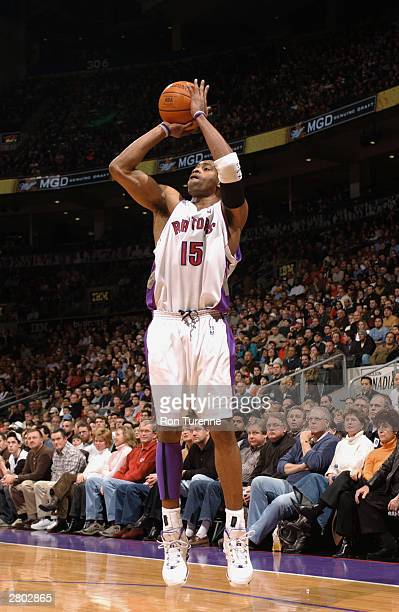 Vince Carter of the Toronto Raptors shoots against the Seattle Sonics during the game at Air Canada Centre on December 7 2003 in Toronto Canada The...