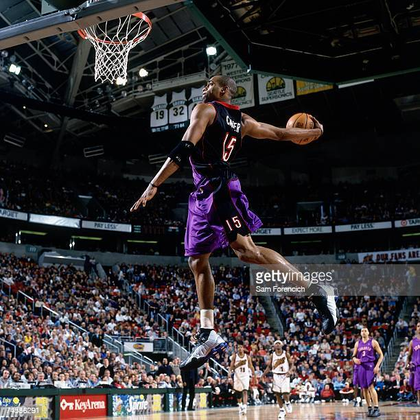 Vince Carter of the Toronto Raptors soars for a dunk against the Seattle SuperSonics during a 2001 NBA game at the Key Arena in Seattle Washington...