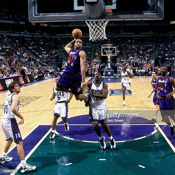 Vince Carter of the Toronto Raptors soars for a dunk during a 1999 NBA game against the Milwaukee Bucks at the Bradley Center in Milwaukee Wisconsin...