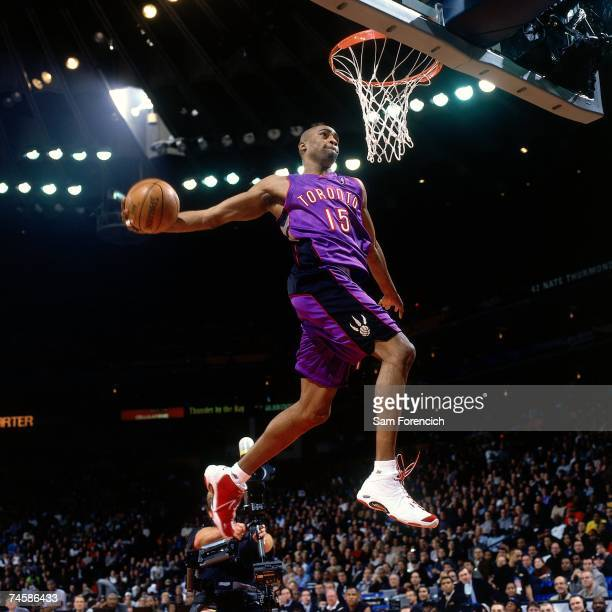 Vince Carter of the Toronto Raptors soars for a dunk during a 2000 NBA game NOTE TO USER User expressly acknowledges that by downloading and or using...