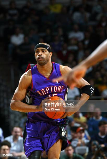 Vince Carter of the Toronto Raptors studies the court during the game against the Milwaukee Bucks on April 14 2004 at the Bradley Center in Milwaukee...