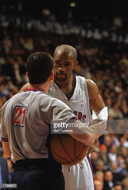 Vince Carter of the Toronto Raptors talks with official Tim Donacghy during the game against the Los Angeles Clippers at Air Canada Centre on...