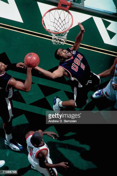 Vince Carter of the United States National Team attempts a layup against the United States Select Team during a pre-Olympic exhibition game at Stan...