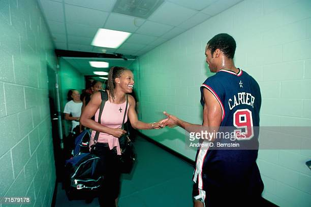 Vince Carter of the United States National Team is greeted by Nikki McCray of the United States Women's National Team during an exhibition match...