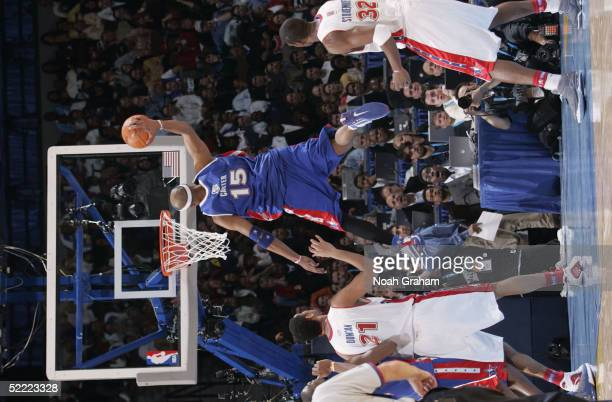 Vince Carter oft the Eastern Conference AllStars catches his own pass off the back board for a dunk against the Western Conference in the 54th...
