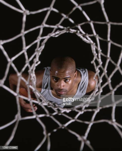 Vince Carter, Power Forward for the Toronto Raptors looks up through the net during a photoshoot for Puma Sportswear on 17th August 1998 at the...