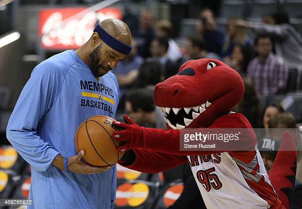 TORONTO ON NOVEMBER 19 Vince Carter talks to The Raptor before the game as the Toronto Raptors beat the Memphis Grizzlies 9692 in the Air Canada...