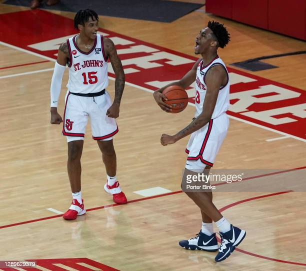 Vince Cole and Isaih Moore of the St. John's Red Storm celebrate their win over the St. Peter's Peacocks during a game at Carnesecca Arena on...