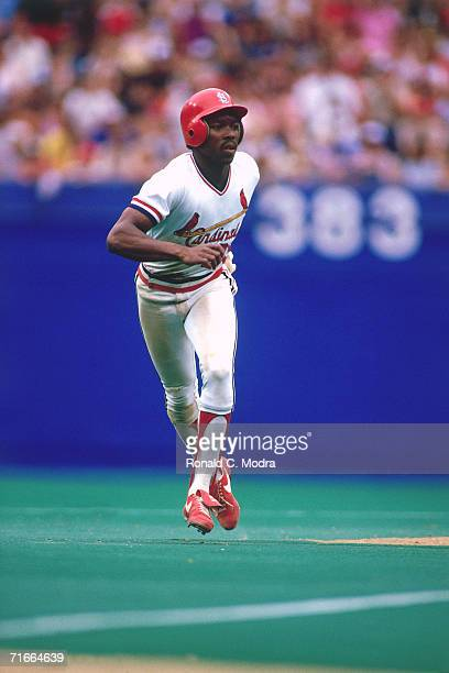 Vince Coleman of the St. Louis Cardinals leads off second base against the Atlanta Braves at Busch Stadium during a regular season game on May 21,...