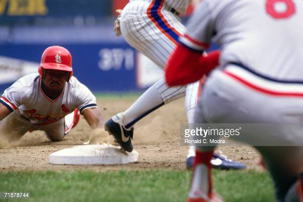 Vince Coleman of the St Louis Cardinals steals third base against the New York Mets during a June 9 l985 season game in Flushing New York The Mets...