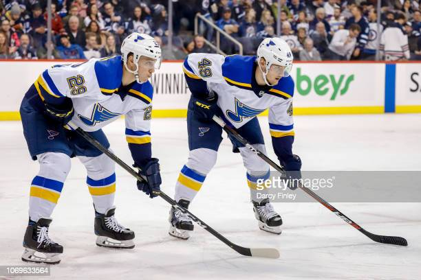 Vince Dunn and Ivan Barbashev of the St Louis Blues get set during a second period against the Winnipeg Jets at the Bell MTS Place on December 7 2018...