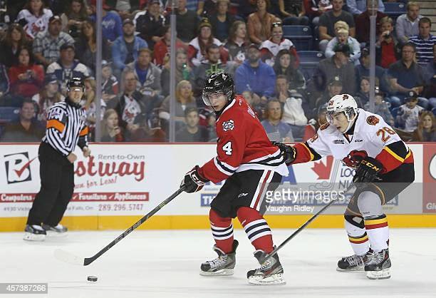 Vince Dunn of the Niagara Ice Dogs is chased down by David Tomasek of the Belleville Bulls in an OHL game at the Meridian Centre on October 16 2014...