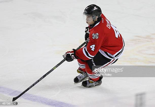 Vince Dunn of the Niagara Ice Dogs skates during an OHL game against the Belleville Bulls at the Meridian Centre on October 16, 2014 in St...