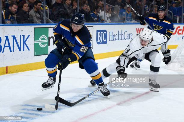 Vince Dunn of the St Louis Blues and Adrian Kempe of the Los Angeles Kings battle for control of the puck at Enterprise Center on November 19 2018 in...