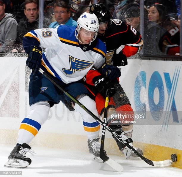 Vince Dunn of the St. Louis Blues battles for the puck against Troy Terry of the Anaheim Ducks during the game on January 23, 2019 at Honda Center in...