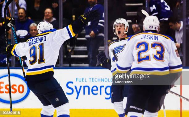 Vince Dunn of the St Louis Blues celebrates with teammates Vladimir Tarasenko Dmitrij Jaskin after scoring the game winning overtime goal against the...