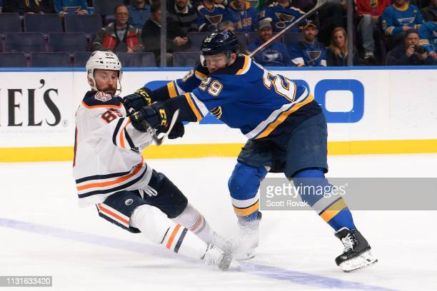 Vince Dunn of the St. Louis Blues checks Sam Gagner of the Edmonton Oilers at Enterprise Center on March 19, 2019 in St. Louis, Missouri.