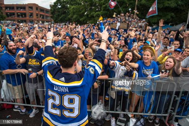 Vince Dunn of the St. Louis Blues cheers with fans during the St Louis Blues Victory Parade and Rally after winning the 2019 Stanley Cup Final on...