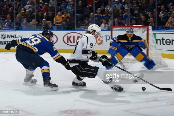 Vince Dunn of the St Louis Blues defends against Adrian Kempe of the Los Angeles Kings at Scottrade Center on October 30 2017 in St Louis Missouri
