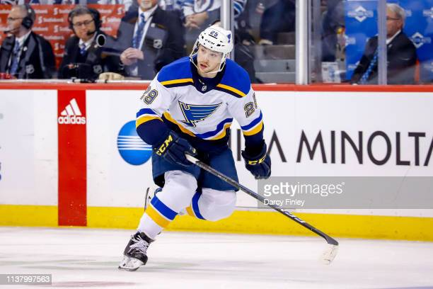 Vince Dunn of the St Louis Blues follows the play down the ice during first period action against the Winnipeg Jets in Game Five of the Western...