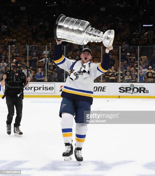 Vince Dunn of the St. Louis Blues holds the Stanley Cup following the Blues victory over the Boston Bruins at TD Garden on June 12, 2019 in Boston,...
