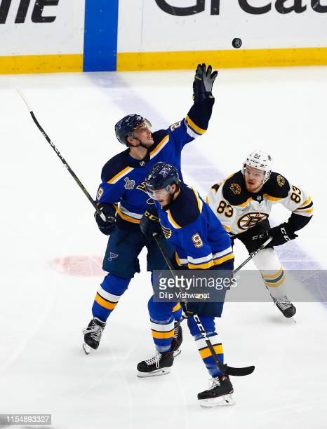 Vince Dunn of the St Louis Blues reaches for the puck against Karson Kuhlman of the Boston Bruins during the third period in Game Six of the 2019 NHL...