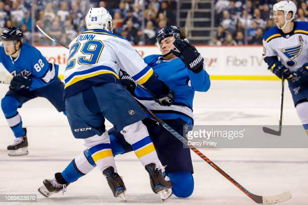 Vince Dunn of the St Louis Blues runs into Brendan Lemieux of the Winnipeg Jets during second period action at the Bell MTS Place on December 7 2018...