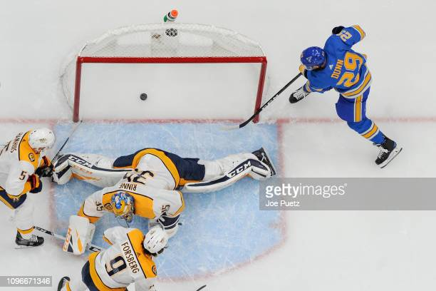 Vince Dunn of the St Louis Blues scores a goal past Pekka Rinne of the Nashville Predators at Enterprise Center on February 9 2019 in St Louis...