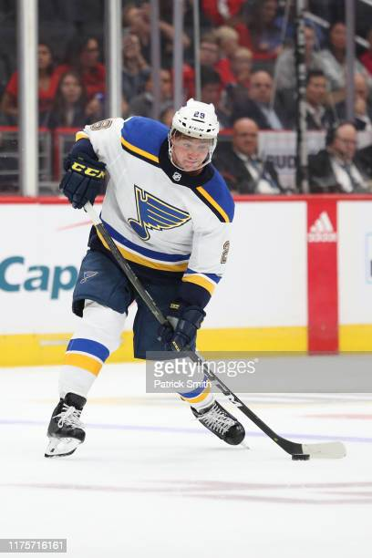 Vince Dunn of the St. Louis Blues shoots the puck against the Washington Capitals during a preseason NHL game at Capital One Arena on September 18,...
