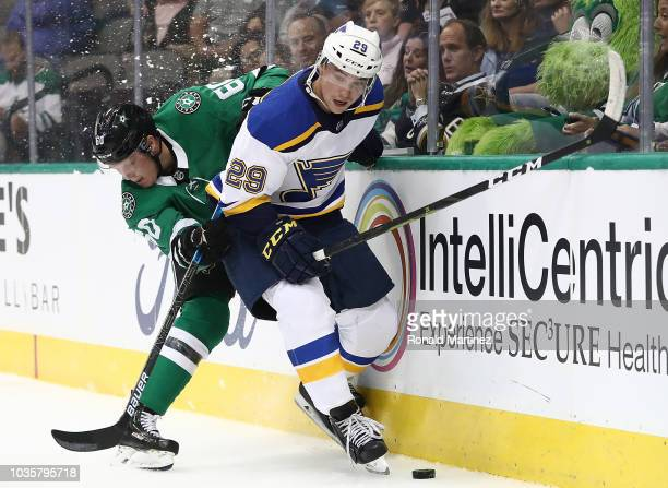 Vince Dunn of the St. Louis Blues skates the puck against the Ty Dellandrea of the Dallas Stars during a preseason game at American Airlines Center...