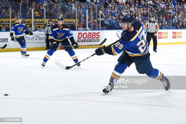 Vince Dunn of the St. Louis Blues takes a shot against the New York Rangers at Enterprise Center on December 31, 2018 in St. Louis, Missouri.