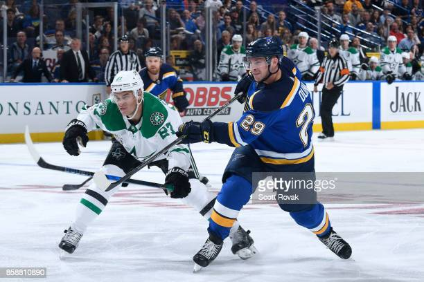Vince Dunn of the St Louis Blues takes a shot as Adam Cracknell of the Dallas Stars defends on October 7 2017 at Scottrade Center in St Louis Missouri