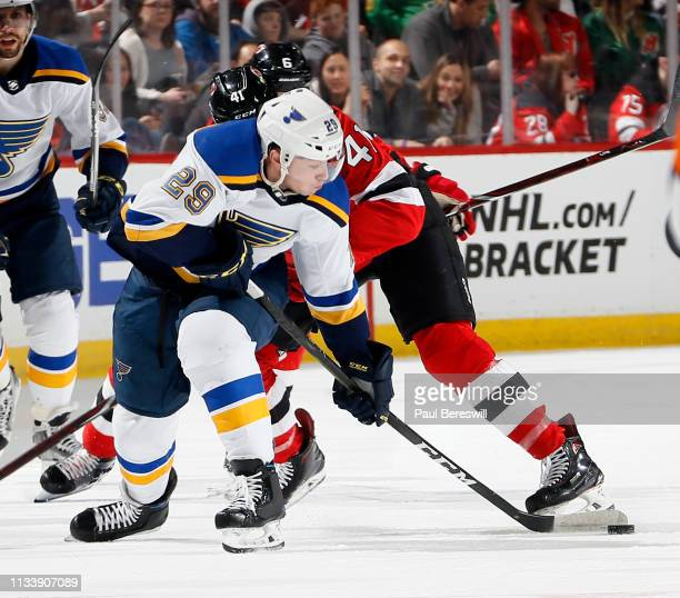 Vince Dunn of the St. Louis Blues takes the puck up ice in the third period of an NHL hockey game against the New Jersey Devils at the Prudential...