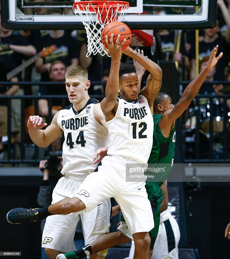 Vince Edwards #12 of the Purdue Boilermakers comes down with a rebound during the game against the Cleveland State Vikings at Mackey Arena on December 10, 2016 in West Lafayette, Indiana.