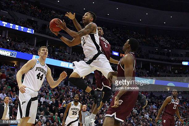 Vince Edwards of the Purdue Boilermakers shoots the ball ober Daniel Green of the Arkansas Little Rock Trojans during the first round of the 2016...
