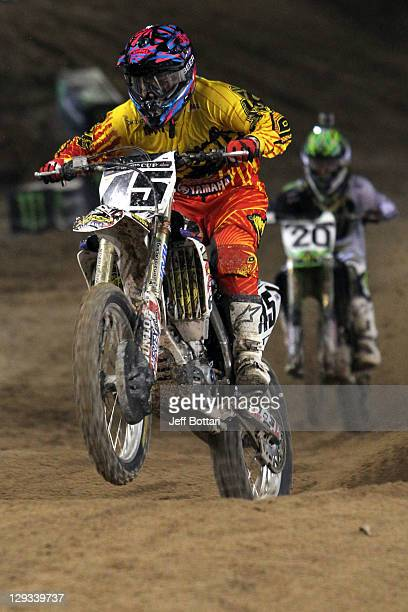 Vince Friese rider of the Rock River/Dunlop Yamaha 450 leads Broc Tickle rider of the Monster Energy/Pro Circuit Kawasaki 450 during Main Event 1 of...