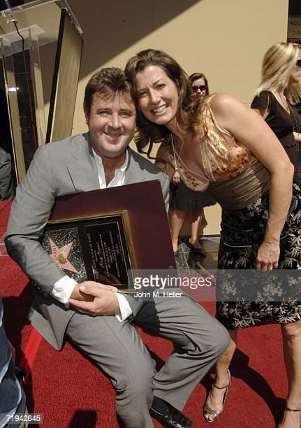 Vince Gill and Amy Grant attend the the unveiling of her star on The Hollywood Walk of Fame September 19 2006 in Hollywood California